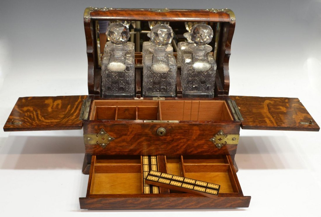 504: 19TH C. ENGLISH TIGER OAK TANTALUS & GAMES BOX