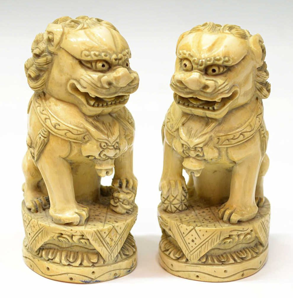 113: (2)CHINESE CARVED IVORY FOO LIONS IN A SEATED POSE