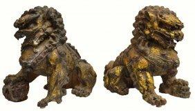 4: PAIR CHINESE PARCEL GILT CAST IRON FOO LIONS