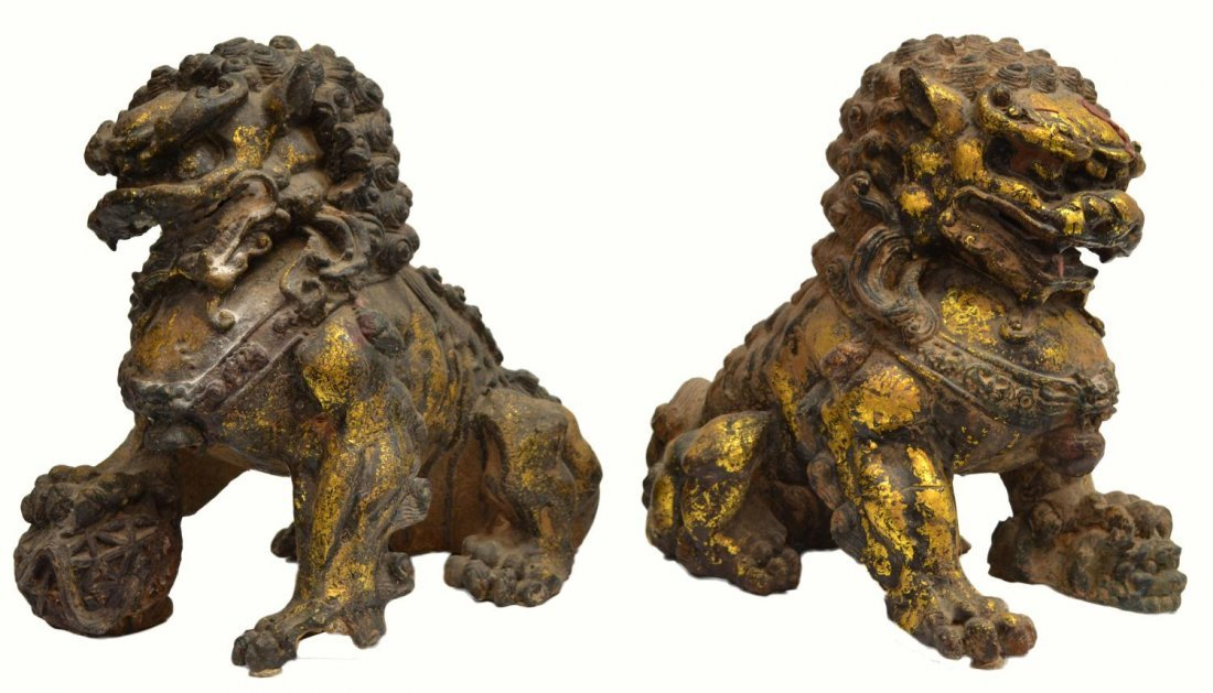 4: PAIR CHINESE PARCEL GILT CAST IRON FOO LIONS