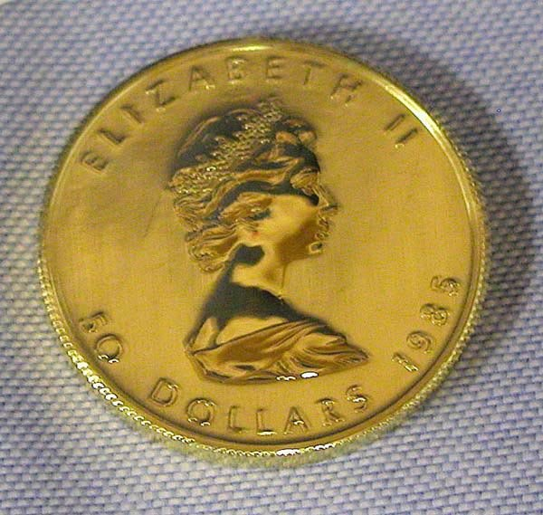 5: 1 CANADA GOLD MAPLE LEAF $50 COIN.