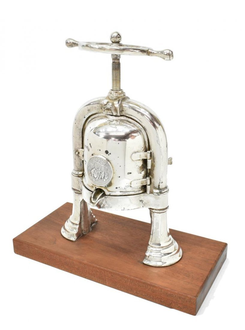EARLY 20TH CENTURY SILVERPLATED DUCK PRESS