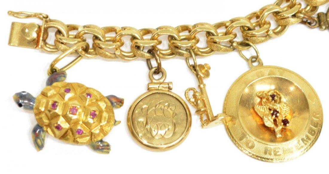 LADIES ESTATE 14KT YELLOW GOLD CHARM BRACELET - 6