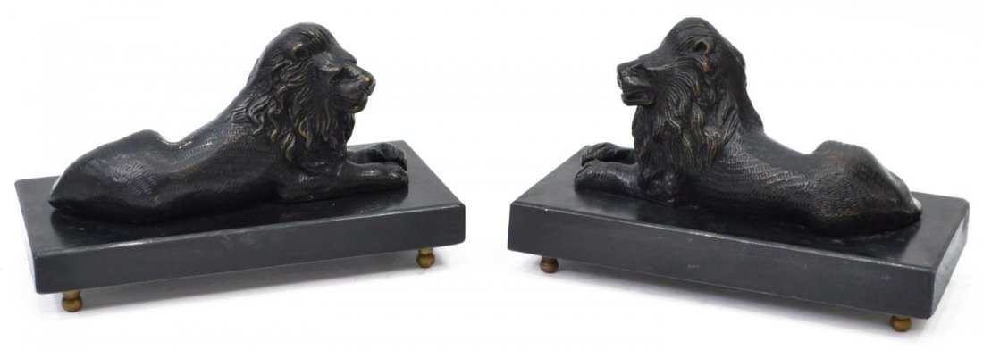 (2) PATINATED BRONZE RECUMENT LIONS ON MARBLE BASE
