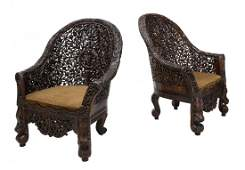 (2) HIGHLY CARVED ANGLO-INDIAN TEAKWOOD ARM CHAIRS