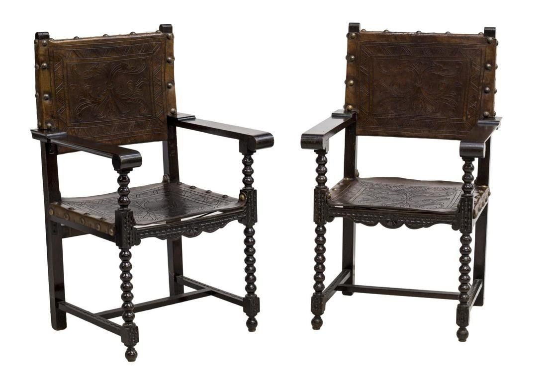 (2)SPANISH BAROQUE REVIVAL EMBOSSED LEATHER CHAIRS