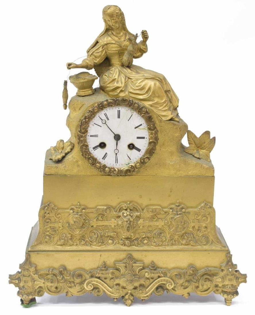 CONTINENTAL GILT METAL SPINNING WOMAN MANTEL CLOCK