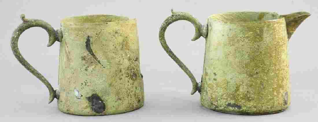 Two metal creamers recovered from the Empress of