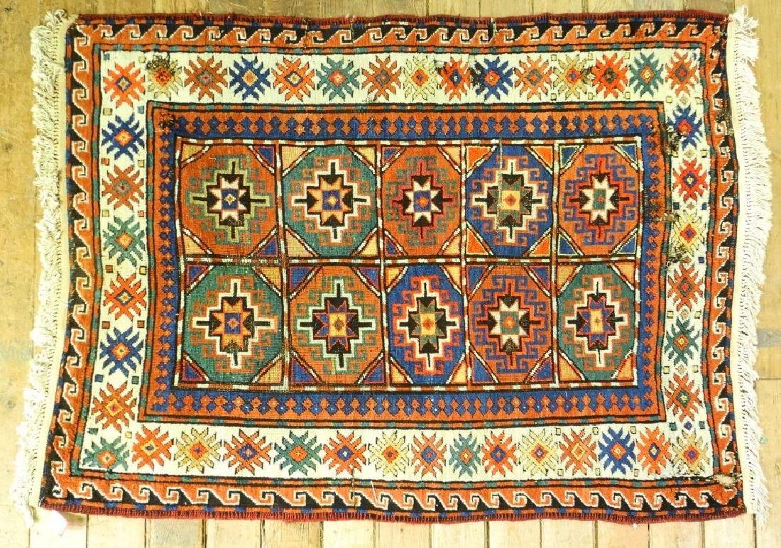 "Kazak rug approx. 5'6"" x 4'1""."