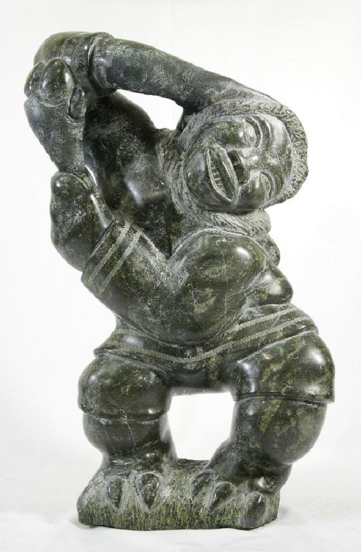 Inuit large soapstone sculpture of a standing man