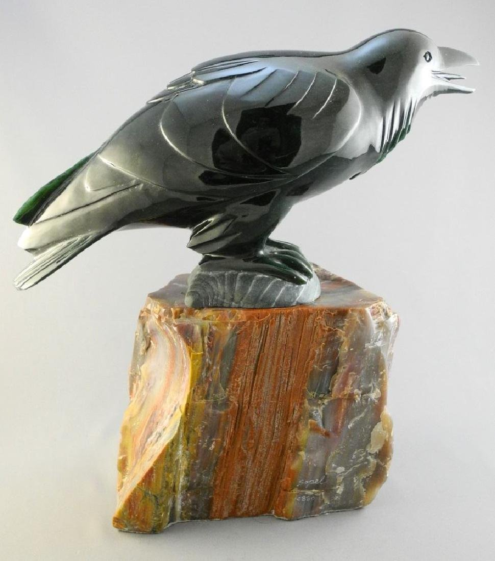 """Nephrite jade carving of a raven- Lyle Sopel, 13 1/2""""."""