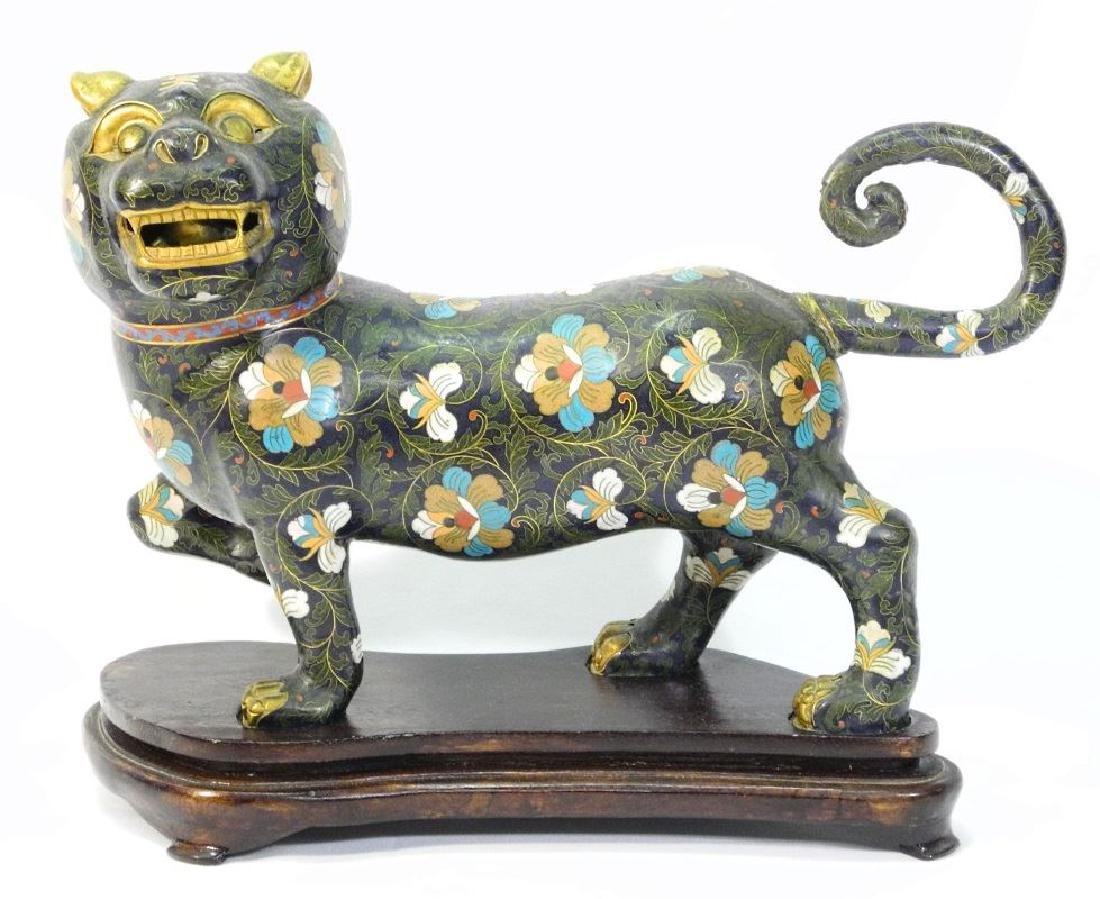 Oriental cloisonne dog of foo on fitted wooden stand,