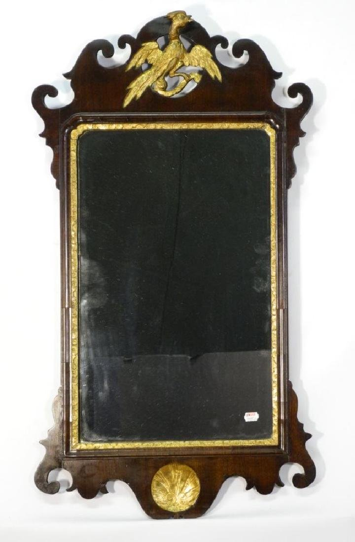 Chippendale carved mahogany gilt decorated wall mirror.