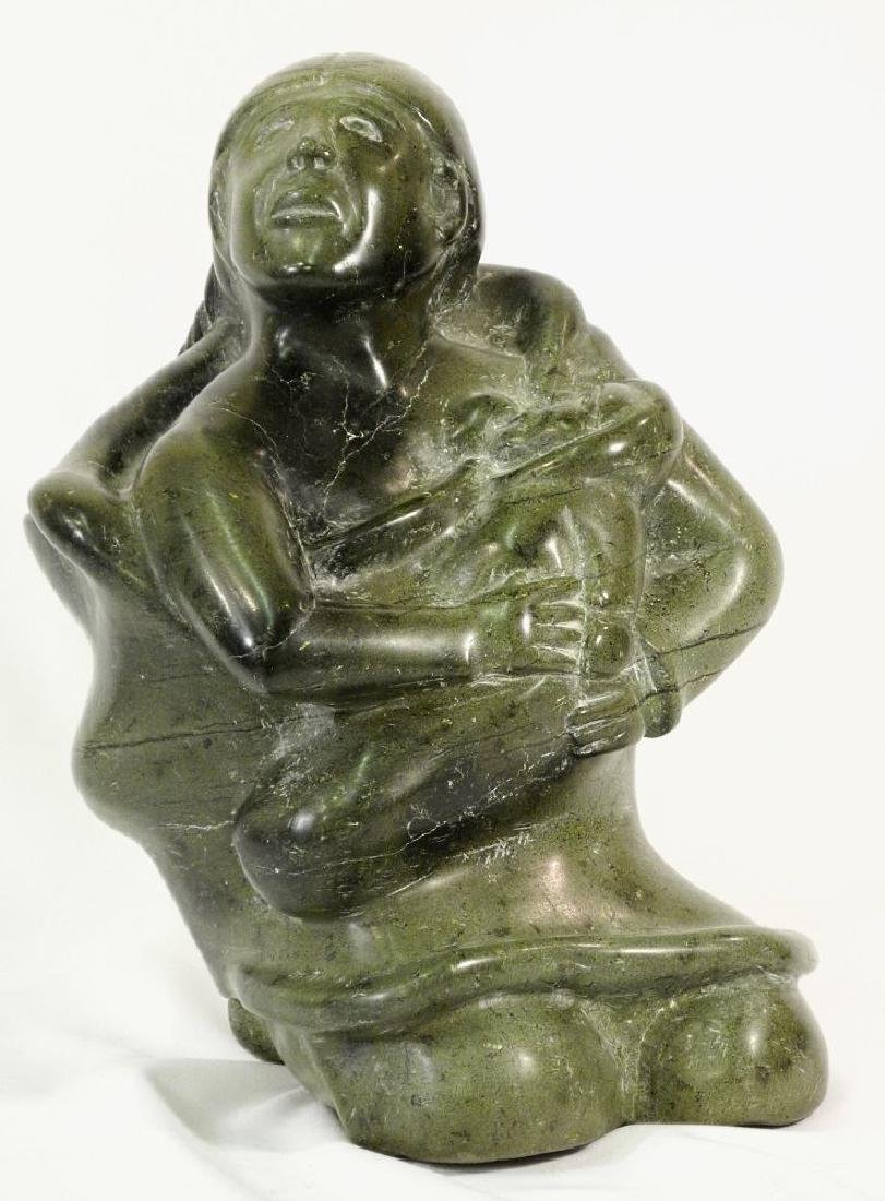 Inuit large soapstone carving of a kneeling mother