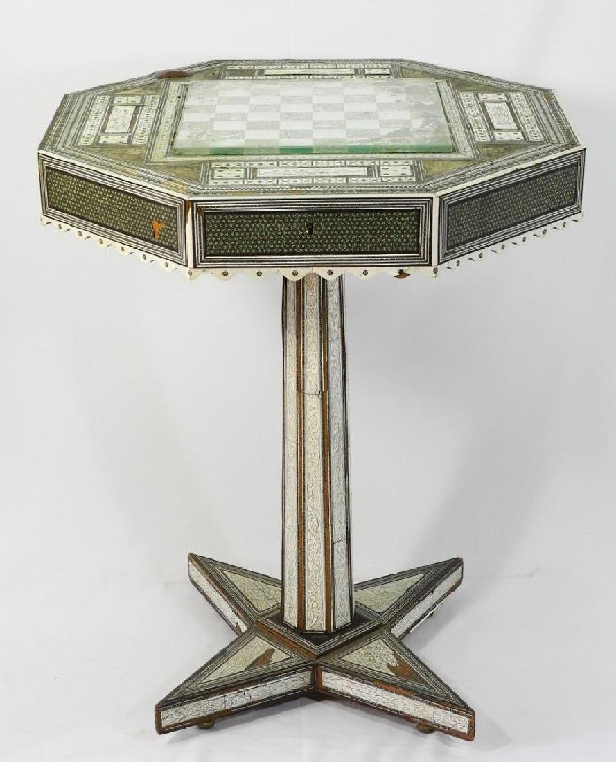 Anglo-Indian Vizagapatam inlaid games table on stand.