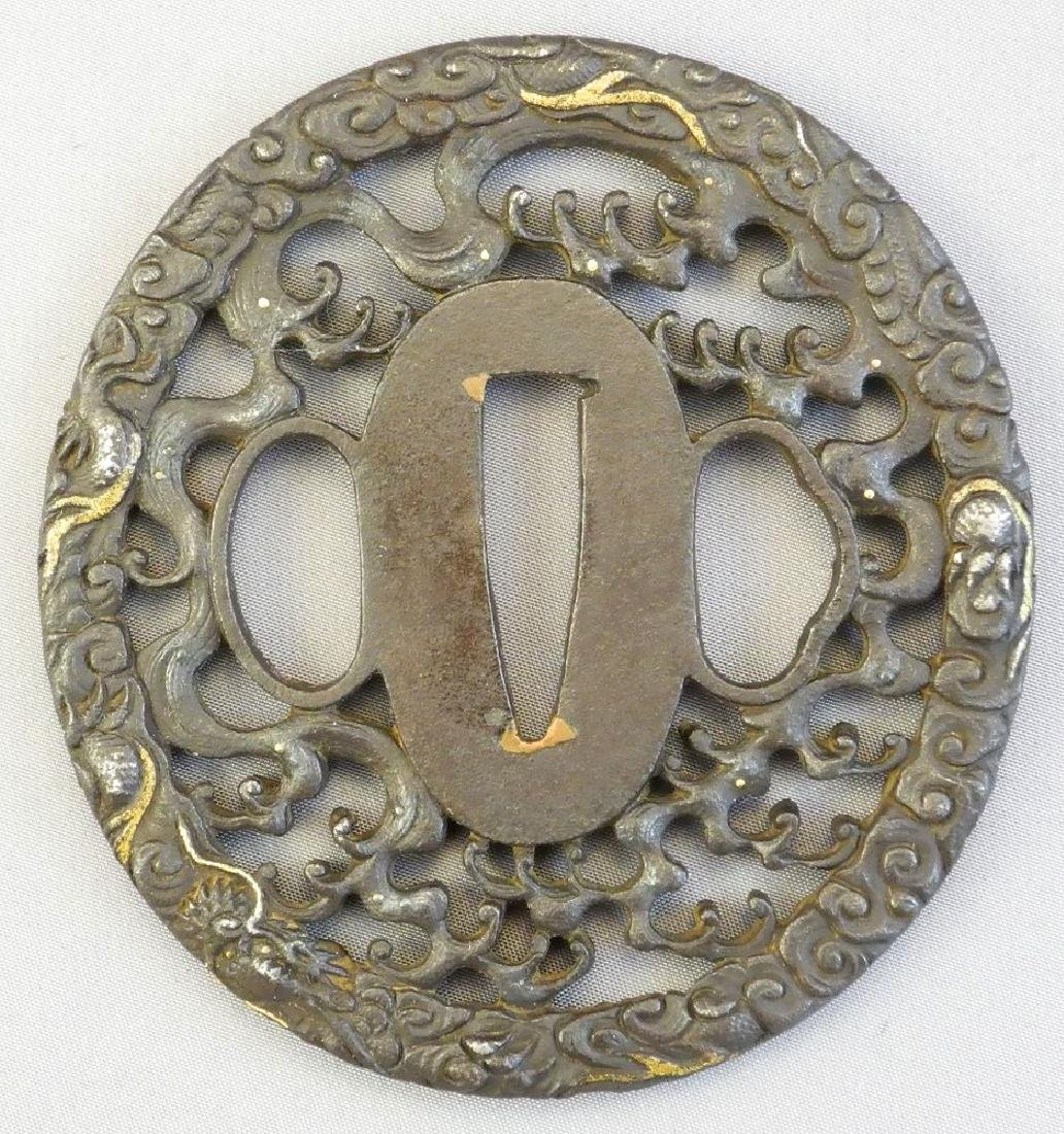 "Japanese pierced metal tsuba, 2 7/8""."