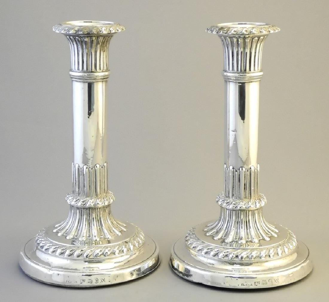 "Pair of Georgian silver candlesticks 8""."