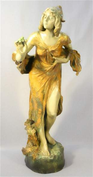 Goldscheider pottery figure of a maiden with a frog