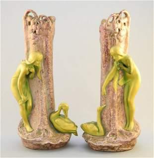 Pair of Austrian pottery figured vases marked EW (Ernst