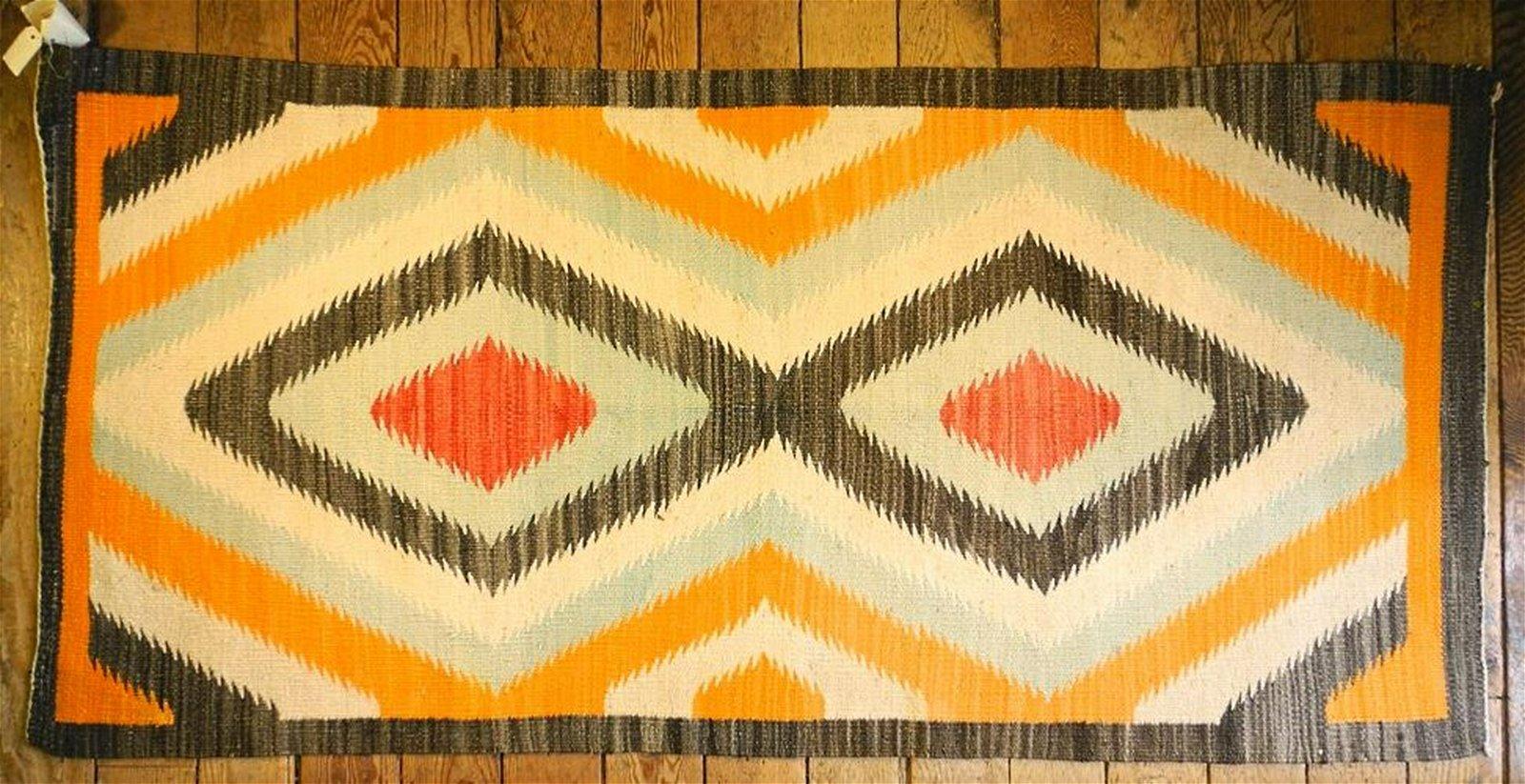 """Red Mesa Dazzler Navajo rug C.1930, 35"""" x 74""""."""
