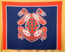 Elaborately decorated button blanket with frog design,