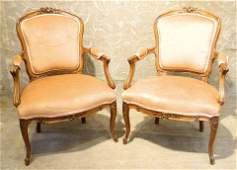 Pair of 19th century Continental walnut open armchairs.