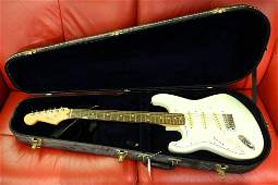 Left handed Fender electric guitar, serial M001175.