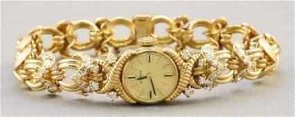Lady's Cyma 9K watch with 18K Diamond strap
