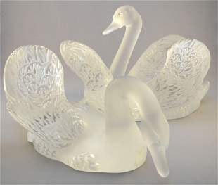 """Pair of Lalique France crystal Swans, 15"""" and 12""""."""