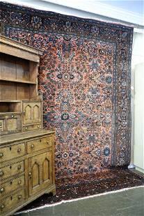 "Antique Sarouk carpet, approximately 8'8"" x 11'8""."