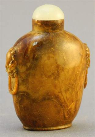 Root Amber carved Snuff Bottle with mask & ring style