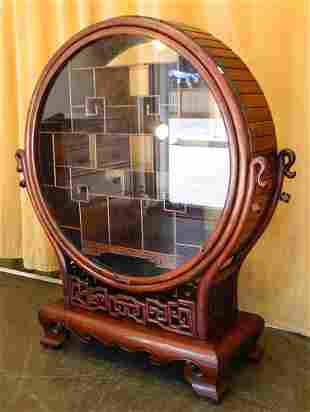 Asian Rosewood Round Cabinet with Offset Shelves.