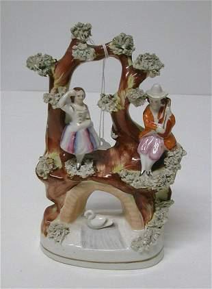 Staffordshire figure group.