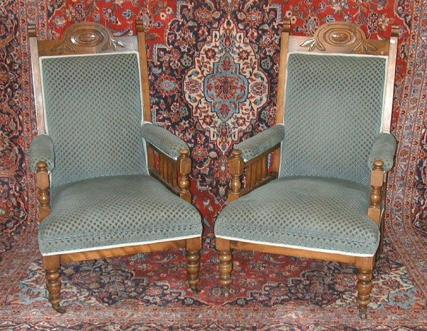 25: Pair of Edwardian blue upholstered open a