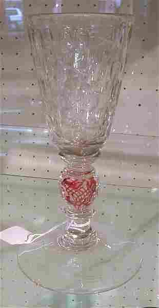 Cut glass goblet with swirl stem.