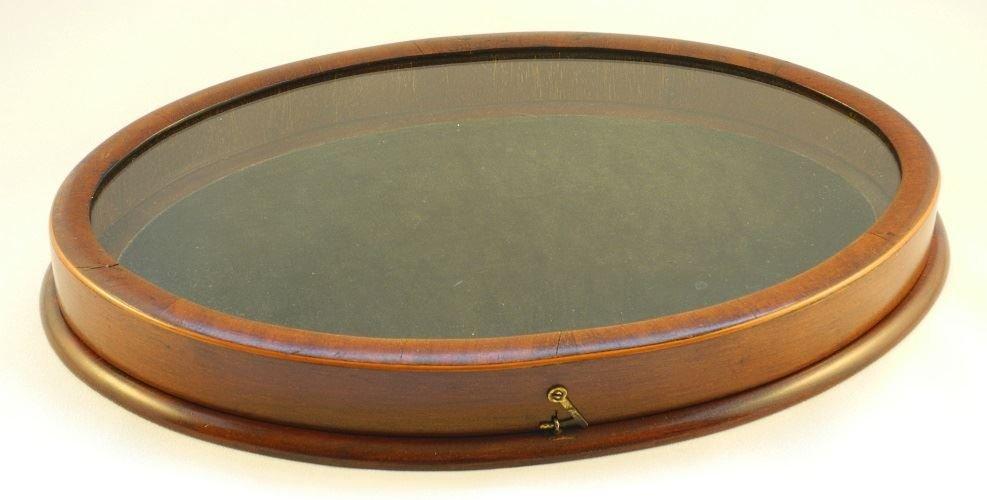 Oval Mahogany Display Case.