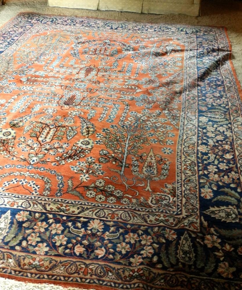 "Approximately 12'8"" x 9' Persian Carpet, showing wear."