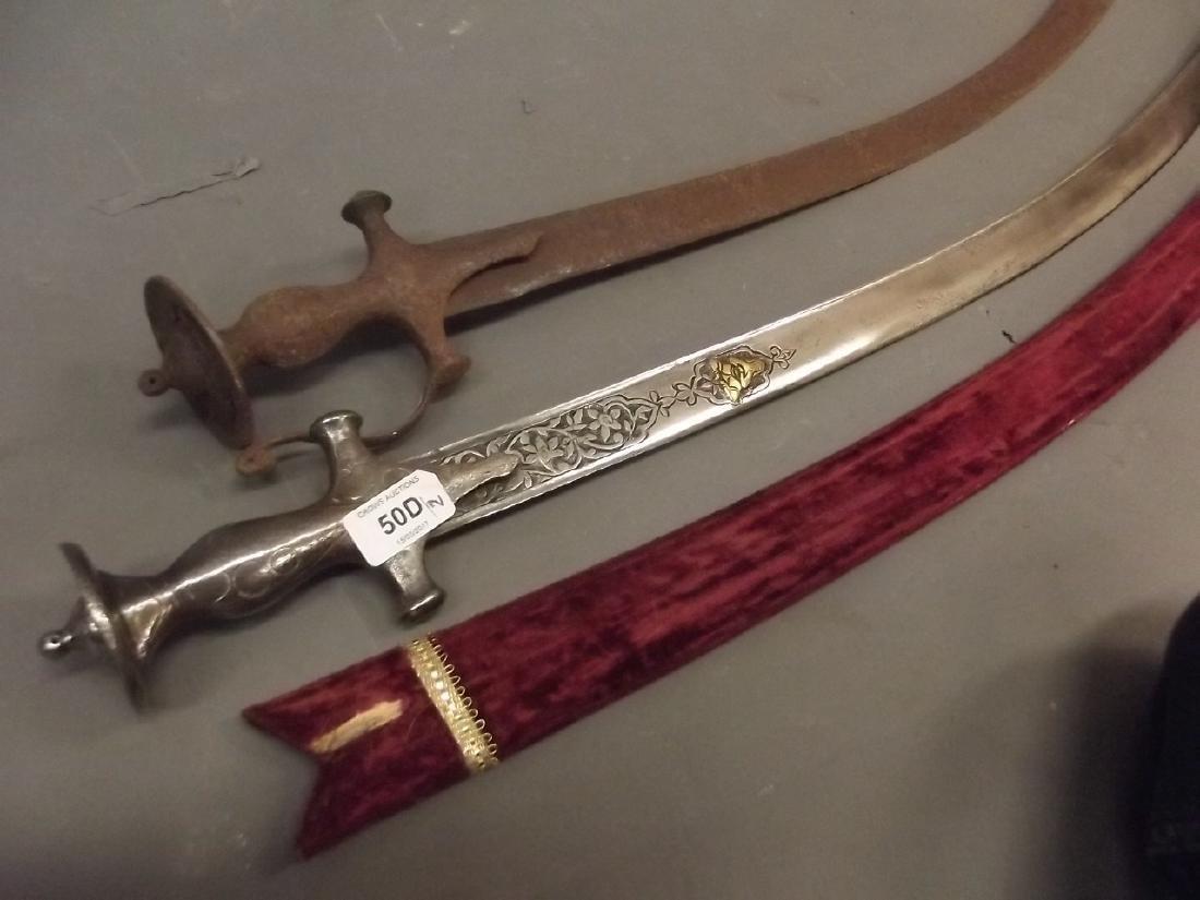 An Indian Talwar sabre with Koftgari decorated blade,