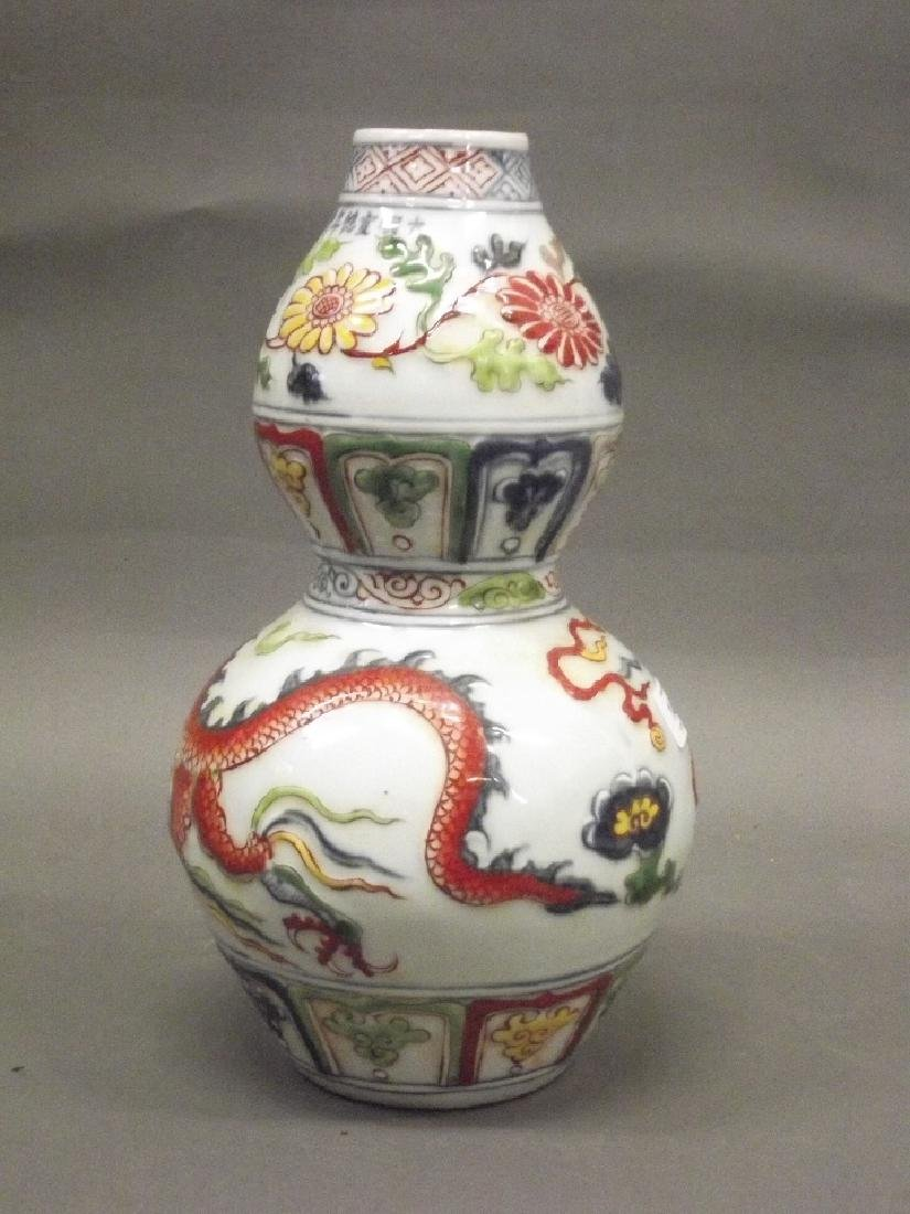 A Chinese earthenware dragon vase with raised enamel - 2
