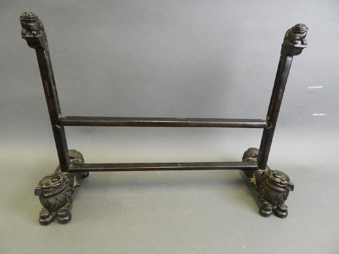 A Chinese carved hardwood screen frame, on Fo dog