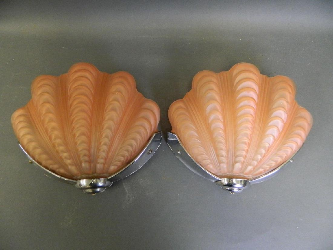 A pair of Art Deco period wall lights with coral