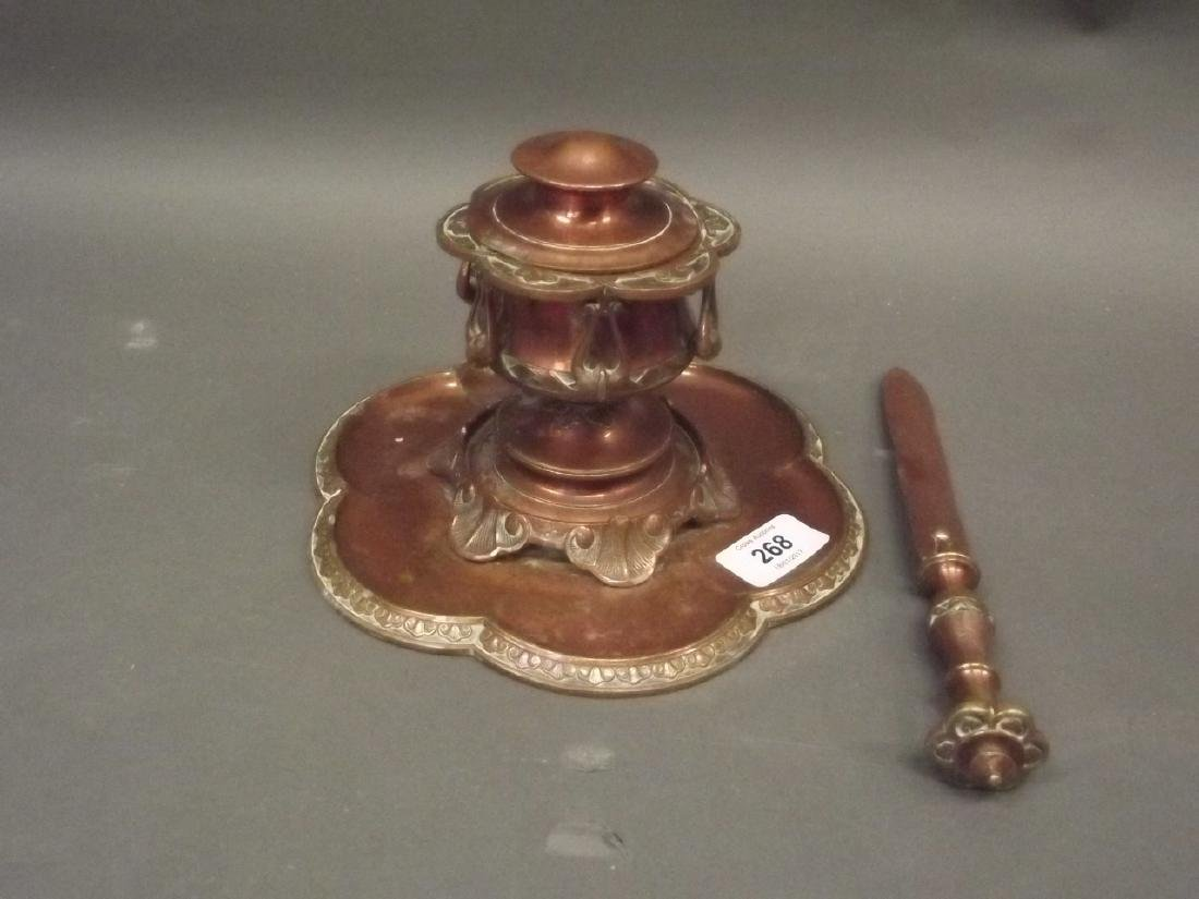 A C19th Arts & Crafts coppered brass inkwell and letter
