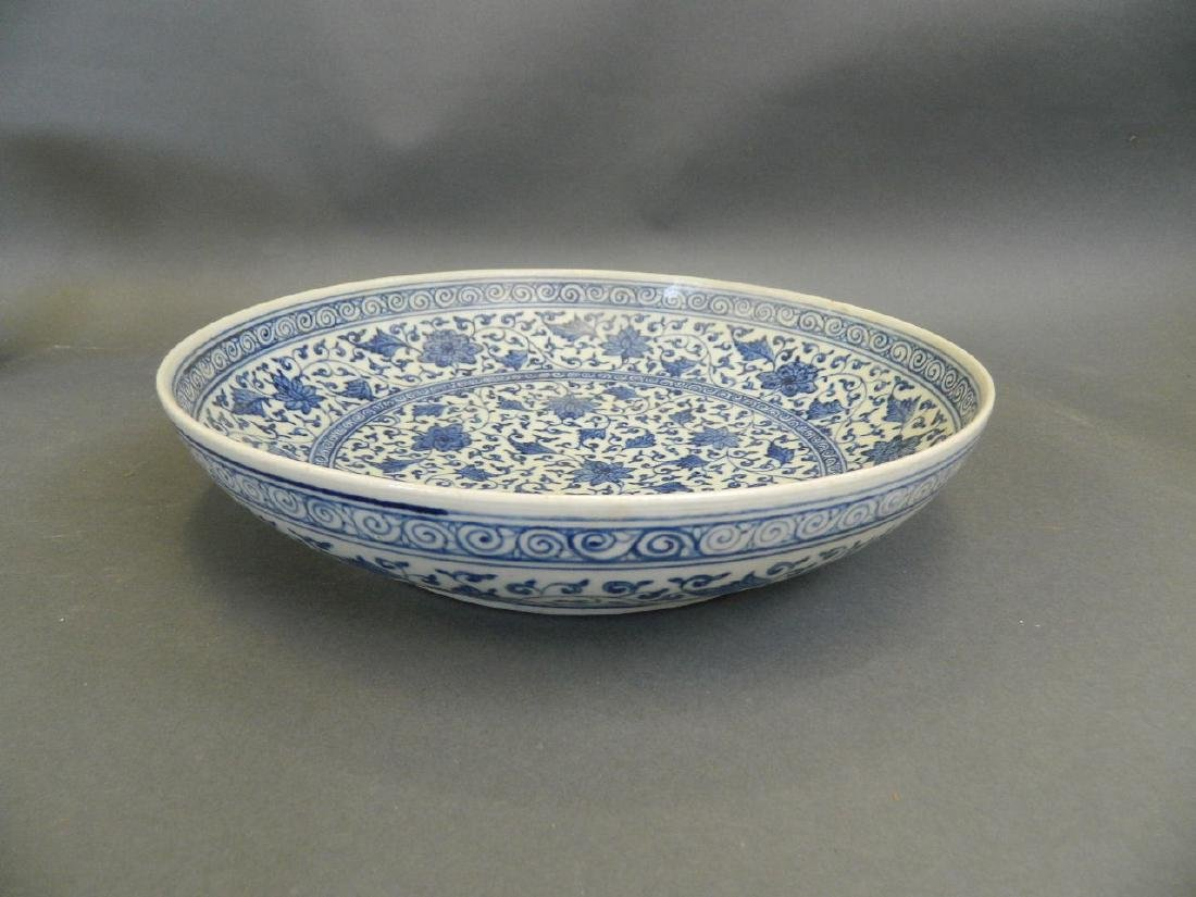 A Chinese blue and white porcelain charger with - 2