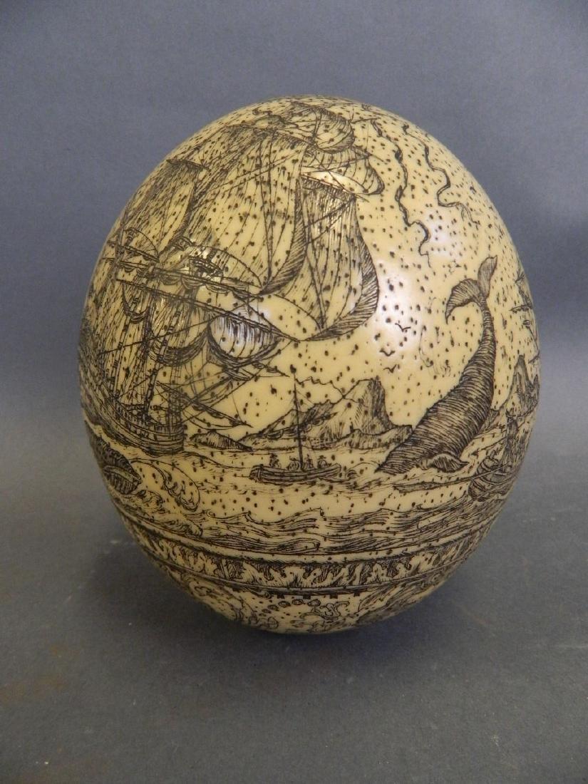 A large Scrimshaw carved egg depicting whaling scenes,