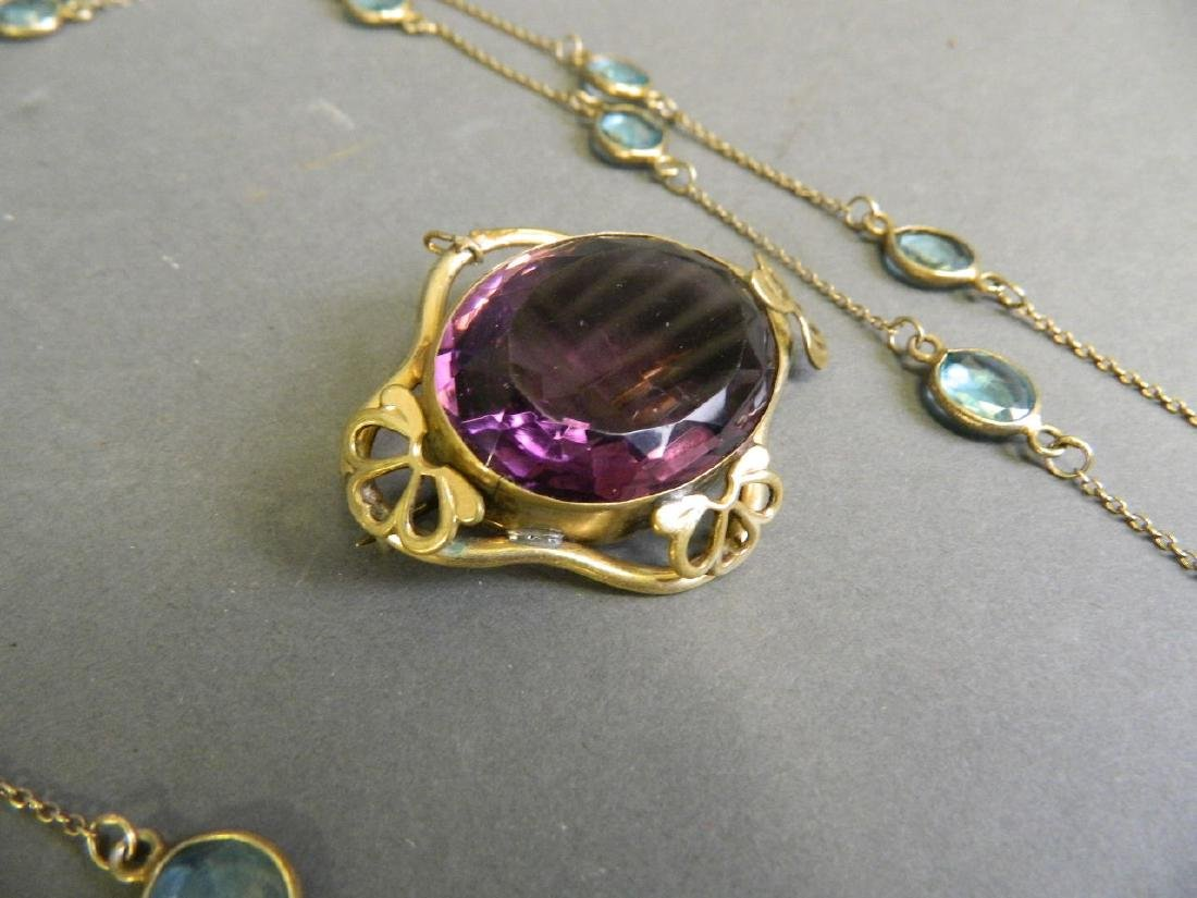 A large amethyst coloured stone and gilt mounted - 3