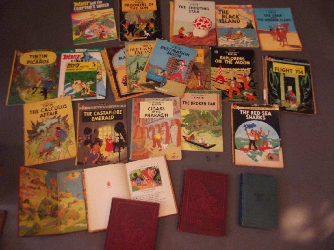 A collection of Hergé 'Adventures of Tintin' soft back