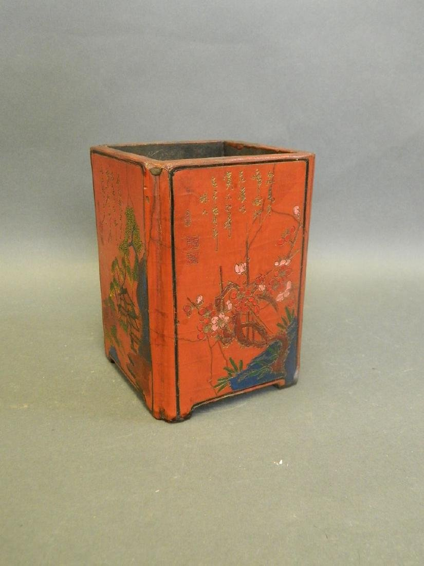 A Chinese red lacquered wood brush pot with incised and