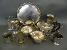 A three piece silver plated tea set with petal shaped