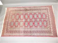 A Turkish hand woven wool carpet with medallion designs