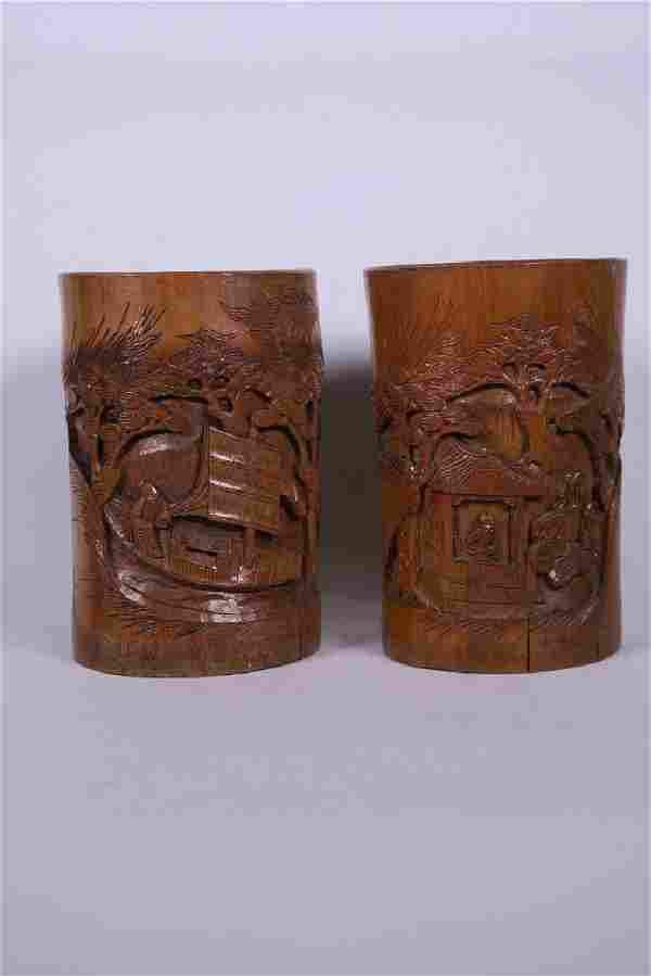 Two Chinese carved bamboo brush pots decorated with